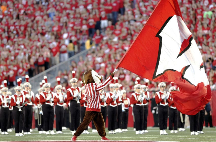 MADISON, WI - SEPTEMBER 15: Bucky Badger, mascot of the Wisconsin Badgers, waves the school flag during pre-game before the start of the game between the Utah State Aggies and the Wisconsin Badgers September 15, 2012 at Camp Randall Stadium in Madison, Wisconsin. (Photo by Tom Lynn/Getty Images)