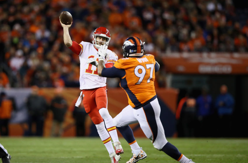 DENVER, CO - NOVEMBER 27: Alex Smith #11 of the Kansas City Chiefs is pressured by Billy Winn #97 of the Denver Broncos at Sports Authority Field at Mile High on November 27, 2016 in Denver, Colorado. (Photo by Ezra Shaw/Getty Images)