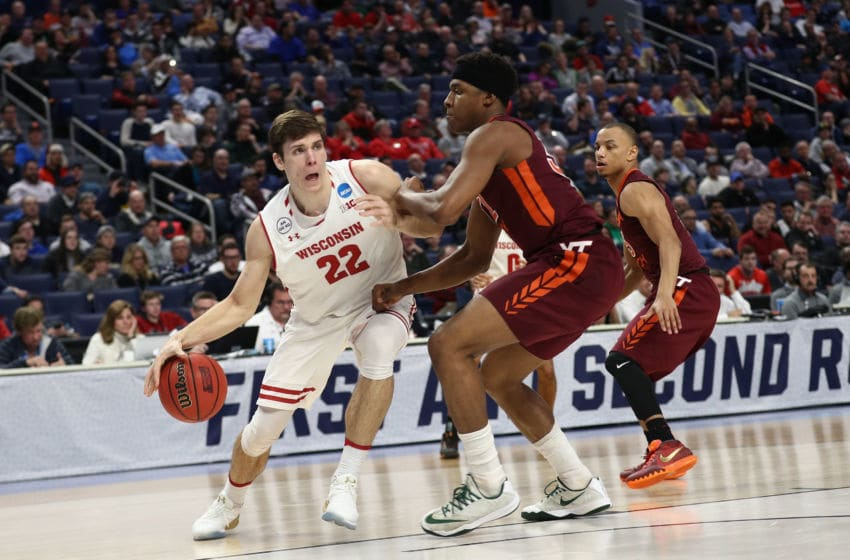 BUFFALO, NY - MARCH 16: Ethan Happ #22 of the Wisconsin Badgers drives against Zach LeDay #32 of the Virginia Tech Hokies in the second half during the first round of the 2017 NCAA Men's Basketball Tournament at KeyBank Center on March 16, 2017 in Buffalo, New York. (Photo by Maddie Meyer/Getty Images)