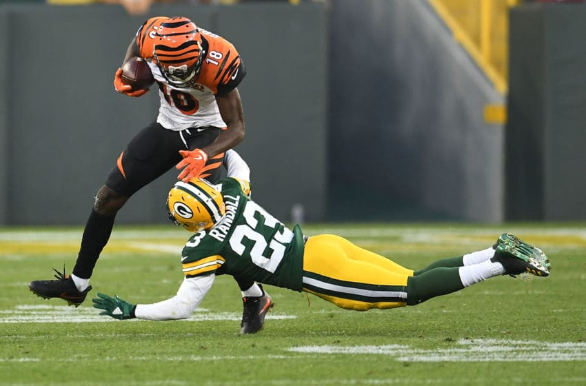 GREEN BAY, WI - SEPTEMBER 24: A.J. Green #18 of the Cincinnati Bengals avoids a tackle by Damarious Randall #23 of the Green Bay Packers during a game at Lambeau Field on September 24, 2017 in Green Bay, Wisconsin. (Photo by Stacy Revere/Getty Images)