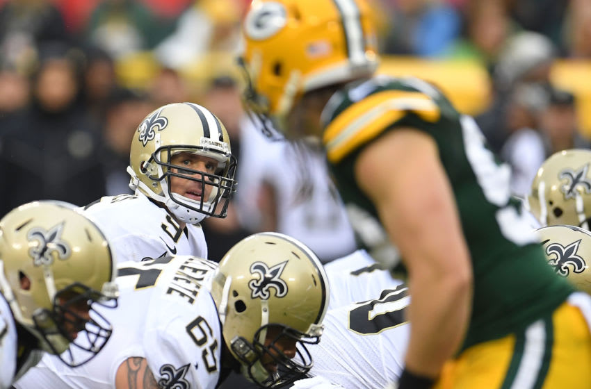 GREEN BAY, WI - OCTOBER 22: Drew Brees #9 of the New Orleans Saints anticipates a snap during a game against the Green Bay Packers at Lambeau Field on October 22, 2017 in Green Bay, Wisconsin. The Saints defeated the Packers 26-17. (Photo by Stacy Revere/Getty Images)