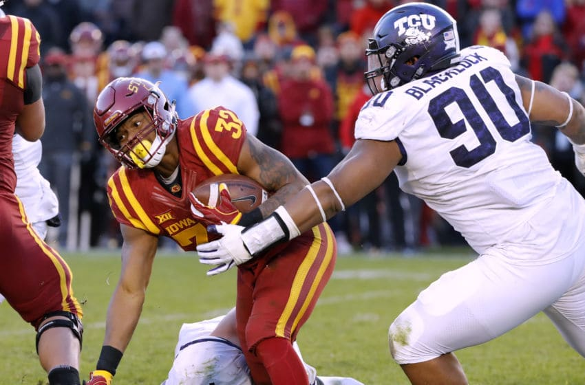 AMES, IA - OCTOBER 28: Running back David Montgomery #32 of the Iowa State Cyclones is tackled by linebacker Ty Summers #42, and defensive tackle Ross Blacklock #90 of the TCU Horned Frogs as he rushed for yards in the second half of play at Jack Trice Stadium on October 28, 2017 in Ames, Iowa. The Iowa State Cyclones won 14-7 over the TCU Horned Frogs. (Photo by David Purdy/Getty Images)