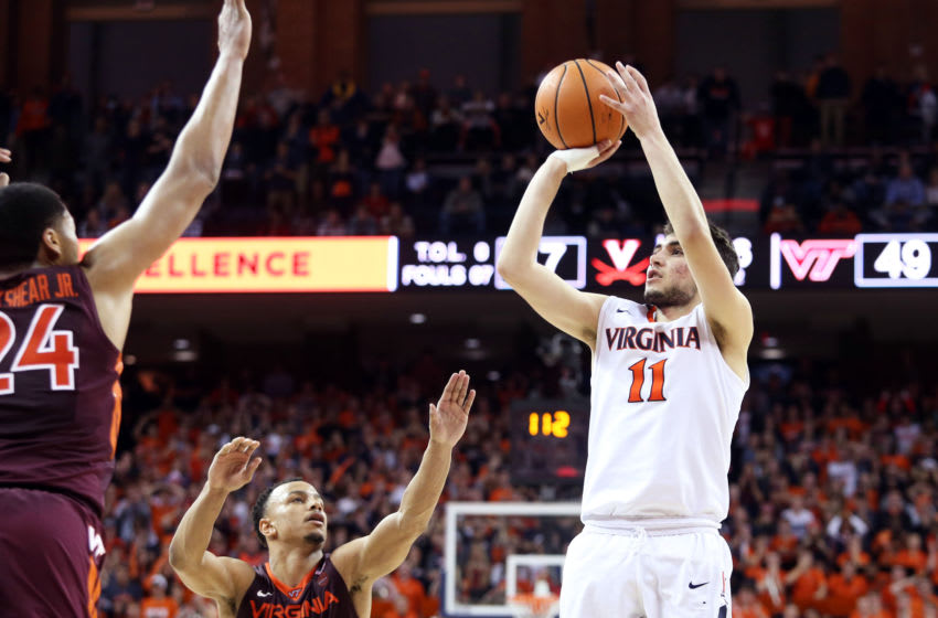 CHARLOTTESVILLE, VA - February 10: Ty Jerome #11 of the Virginia Cavaliers makes the tying shot to send the game to overtime at the end of the second half during a game against the Virginia Tech Hokies at John Paul Jones Arena on February 10, 2018 in Charlottesville, Virginia. Virginia Tech defeated Virginia 61-60. (Photo by Ryan M. Kelly/Getty Images)