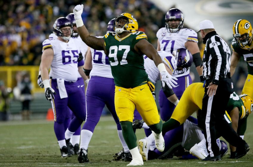 GREEN BAY, WI - DECEMBER 23: Kenny Clark #97 of the Green Bay Packers celebrates after recording a sack in the first quarter against the Minnesota Vikings at Lambeau Field on December 23, 2017 in Green Bay, Wisconsin. (Photo by Dylan Buell/Getty Images)