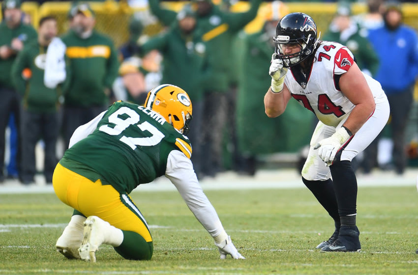 GREEN BAY, WISCONSIN - DECEMBER 09: Ty Sambrailo #74 of the Atlanta Falcons works against Kenny Clark #97 of the Green Bay Packers during a game at Lambeau Field on December 09, 2018 in Green Bay, Wisconsin. The Packers defeated the Falcons 34-20. (Photo by Stacy Revere/Getty Images)