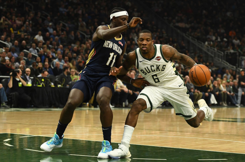 MILWAUKEE, WISCONSIN - DECEMBER 11: Eric Bledsoe #6 of the Milwaukee Bucks is defended by Jrue Holiday #11 of the New Orleans Pelicans during a game at Fiserv Forum on December 11, 2019 in Milwaukee, Wisconsin. NOTE TO USER: User expressly acknowledges and agrees that, by downloading and or using this photograph, User is consenting to the terms and conditions of the Getty Images License Agreement. (Photo by Stacy Revere/Getty Images)