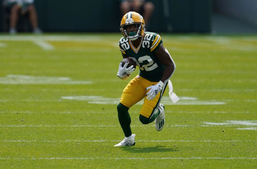 GREEN BAY, WISCONSIN - SEPTEMBER 20: Tyler Ervin #32 of the Green Bay Packers runs for yards during a game against the Detroit Lions at Lambeau Field on September 20, 2020 in Green Bay, Wisconsin. The Packers defeated the Lions 42-21. (Photo by Stacy Revere/Getty Images)