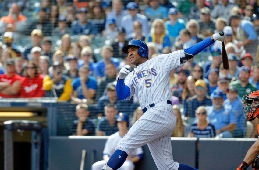 MILWAUKEE, WI - SEPTEMBER 09: Jonathan Schoop #5 of the Milwaukee Brewers hits a grand slam against the San Francisco Giants during the sixth inning at Miller Park on September 9, 2018 in Milwaukee, Wisconsin. (Photo by Jon Durr/Getty Images)