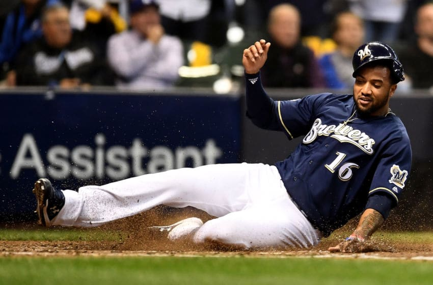MILWAUKEE, WI - OCTOBER 12: Domingo Santana #16 of the Milwaukee Brewers scores a run off of a single hit by Ryan Braun #8 against the Los Angeles Dodgers during the fourth inning in Game One of the National League Championship Series at Miller Park on October 12, 2018 in Milwaukee, Wisconsin. (Photo by Stacy Revere/Getty Images)