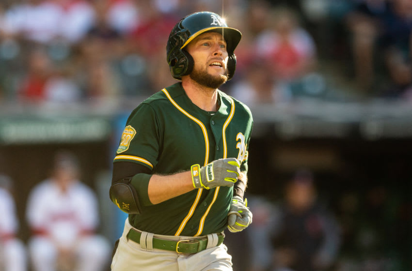 CLEVELAND, OH - JULY 7: Jed Lowrie #8 of the Oakland Athletics rounds the bases on a two run home run during the eighth inning against the Cleveland Indians at Progressive Field on July 7, 2018 in Cleveland, Ohio. (Photo by Jason Miller/Getty Images)