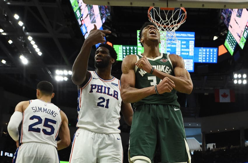 MILWAUKEE, WISCONSIN - MARCH 17: Giannis Antetokounmpo #34 of the Milwaukee Bucks reacts to a dunk over Ben Simmons #25 of the Philadelphia 76ers during the second half of a game at Fiserv Forum on March 17, 2019 in Milwaukee, Wisconsin. NOTE TO USER: User expressly acknowledges and agrees that, by downloading and or using this photograph, User is consenting to the terms and conditions of the Getty Images License Agreement. (Photo by Stacy Revere/Getty Images)