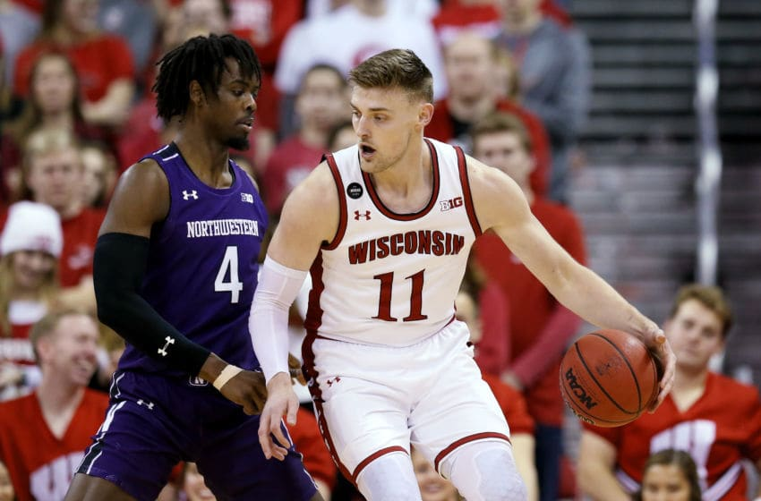 MADISON, WISCONSIN - MARCH 04: Micah Potter #11 of the Wisconsin Badgers dribbles the ball while being guarded by Jared Jones #4 of the Northwestern Wildcats in the first half at the Kohl Center on March 04, 2020 in Madison, Wisconsin. (Photo by Dylan Buell/Getty Images)