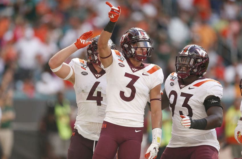 MIAMI, FLORIDA - OCTOBER 05: Caleb Farley #3 of the Virginia Tech Hokies celebrates with teammates against the Miami Hurricanes during the first half at Hard Rock Stadium on October 05, 2019 in Miami, Florida. (Photo by Michael Reaves/Getty Images)