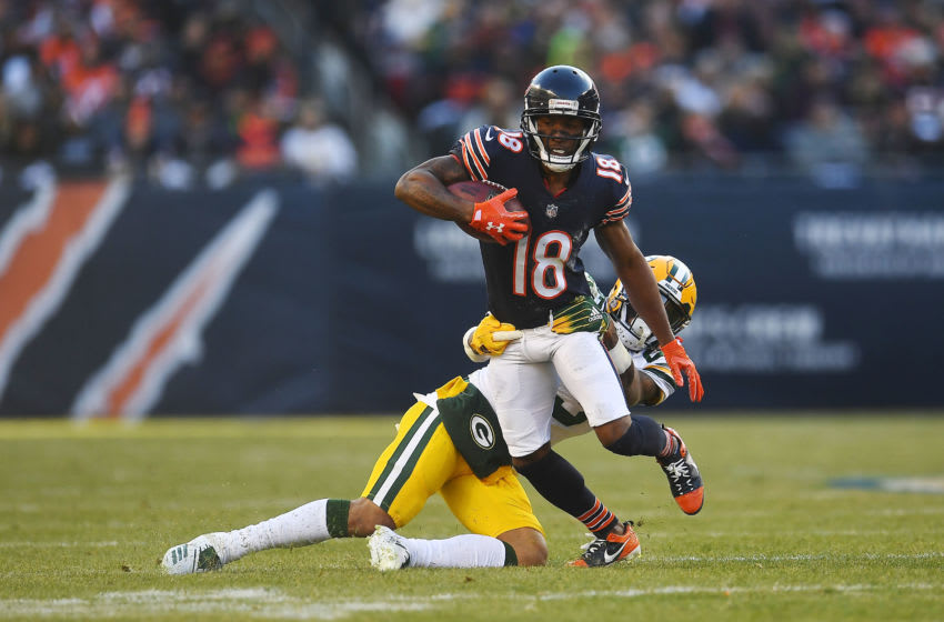 CHICAGO, ILLINOIS - DECEMBER 16: Taylor Gabriel #18 of the Chicago Bears is brought down by Jaire Alexander #23 of the Green Bay Packers during a game at Soldier Field on December 16, 2018 in Chicago, Illinois. The Bears defeated the Packers 24-17. (Photo by Stacy Revere/Getty Images)
