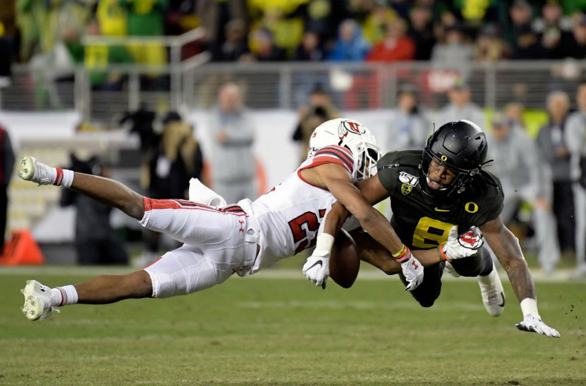 Dec 6, 2019; Santa Clara, CA, USA; Oregon Ducks safety Jevon Holland (8) breaks up a pass intended for Utah Utes wide receiver Jaylen Dixon (25) during the first half of the Pac-12 Conference championship game at Levi's Stadium. Mandatory Credit: Kirby Lee-USA TODAY Sports
