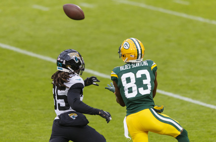 Nov 15, 2020; Green Bay, Wisconsin, USA; Green Bay Packers wide receiver Marquez Valdes-Scantling (83) catches a pass against Jacksonville Jaguars cornerback Sidney Jones IV (35) before scoring a touchdown during the second quarter at Lambeau Field. Mandatory Credit: Jeff Hanisch-USA TODAY Sports