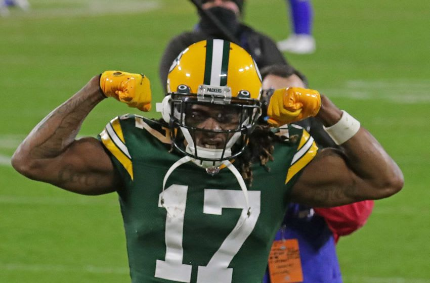 Green Bay Packers wide receiver Davante Adams (17) celebrates the Packers 32-18 win over the Los Angeles Rams during the NFC divisional playoff game Saturday, Jan. 16, 2021, at Lambeau Field in Green Bay, Wis. Packers Rams 04259