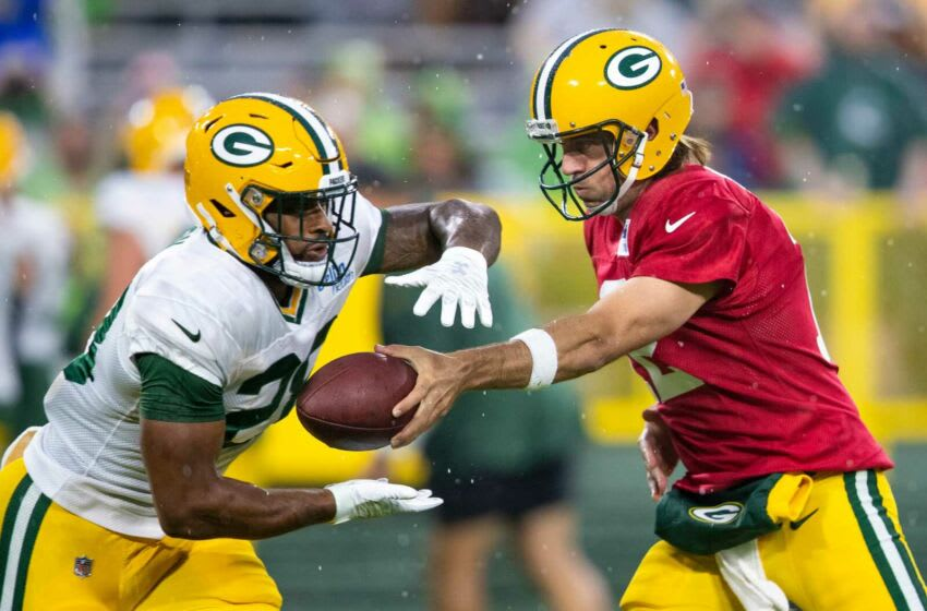 Green Bay Packers quarterback Aaron Rodgers (12) hands the ball off to running back A.J. Dillon (28) during Packers Family Night at Lambeau Field, Saturday, Aug. 7, 2021, in Green Bay, Wis. Samantha Madar/USA TODAY NETWORK-Wisconsin Gpg Packersfamilynight 08072021 0022