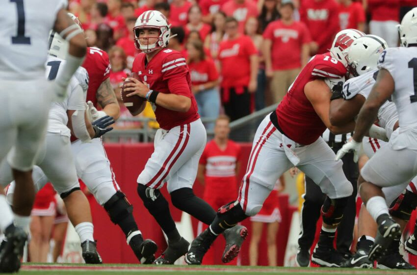 Wisconsin quarterback Graham Mertz (5) looks for a receiver during the fourth quarter of their game against Penn State Saturday, September 4, 2021 at Camp Randall Stadium in Madison, Wis. Penn State beat Wisconsin 16-10. Uwgrid05 17