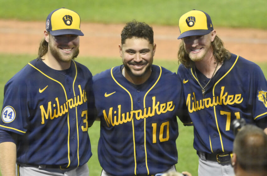 Sep 11, 2021; Cleveland, Ohio, USA; Milwaukee Brewers starting pitcher Corbin Burnes (39), catcher Omar Narvaez (10) and relief pitcher Josh Hader (71) pose for a picture after the Brewers threw a combined no-hitter in a win against the Cleveland Indians at Progressive Field. Mandatory Credit: David Richard-USA TODAY Sports