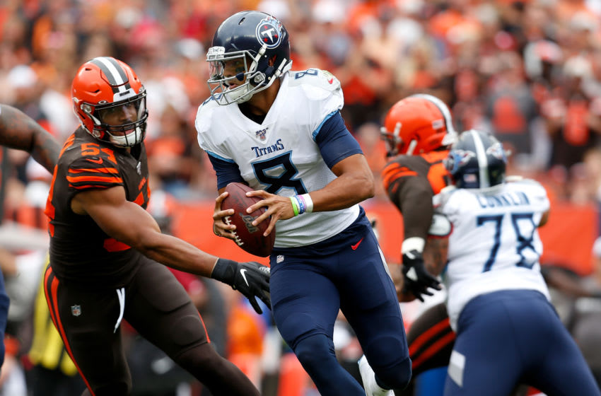 CLEVELAND, OH - SEPTEMBER 8: Marcus Mariota #8 of the Tennessee Titans runs the ball away from Olivier Vernon #54 of the Cleveland Browns during the first quarter at FirstEnergy Stadium on September 8, 2019 in Cleveland, Ohio. (Photo by Kirk Irwin/Getty Images)