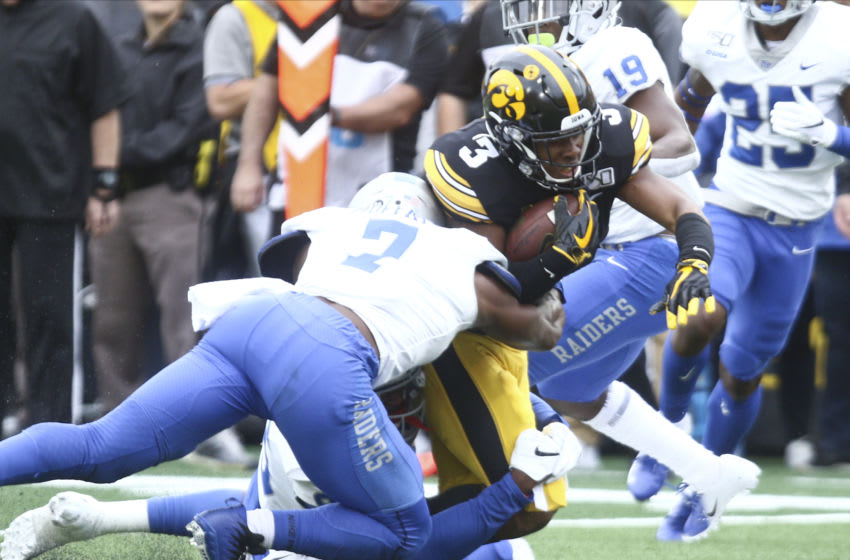 IOWA CITY, IOWA- SEPTEMBER 28: Running back Tyrone Tracy #3 of the Iowa Hawkeyes is tackled during the first half by safety Jovante Moffatt #7 of the Middle Tennessee Blue Raiders on September 28, 2019 at Kinnick Stadium in Iowa City, Iowa. (Photo by Matthew Holst/Getty Images)