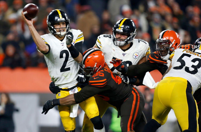 CLEVELAND, OH - NOVEMBER 14: Myles Garrett #95 of the Cleveland Browns knocks down Mason Rudolph #2 of the Pittsburgh Steelers during the fourth quarter at FirstEnergy Stadium on November 14, 2019 in Cleveland, Ohio. Cleveland defeated Pittsburgh 21-7. (Photo by Kirk Irwin/Getty Images)