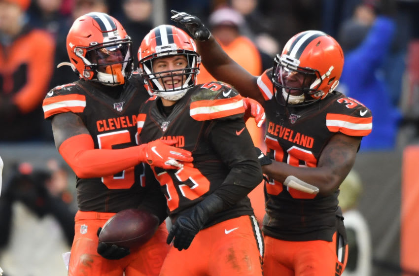 CLEVELAND, OH - NOVEMBER 24: Joe Schobert #53 of the Cleveland Browns celebrates with Mack Wilson #51 and T.J. Carrie #38 of the Cleveland Browns after his second interception of the game in the fourth quarter against the Miami Dolphins at FirstEnergy Stadium on November 24, 2019 in Cleveland, Ohio. Cleveland defeated Miami 41-24. (Photo by Jamie Sabau/Getty Images)