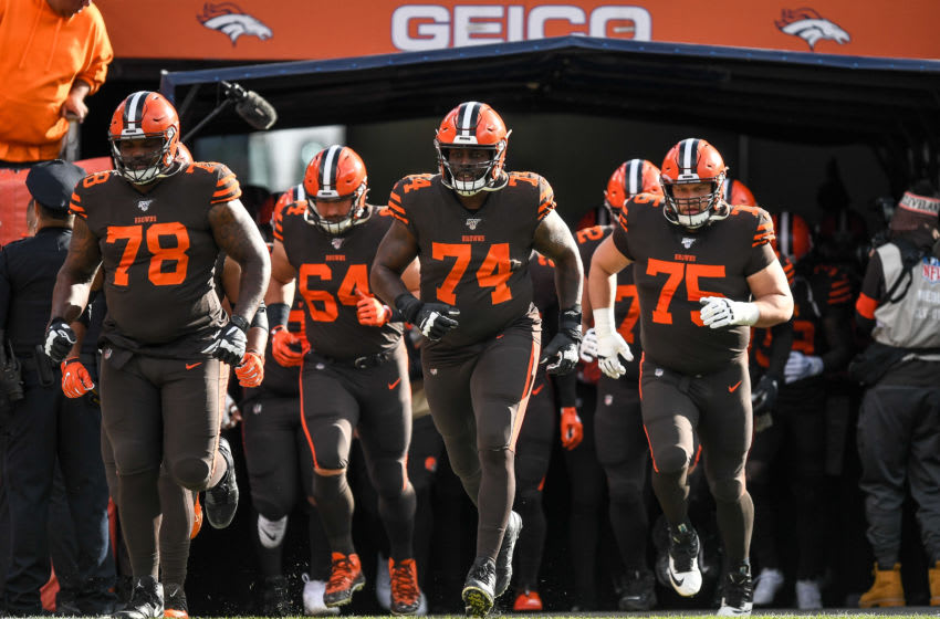 DENVER, CO - NOVEMBER 3: Chris Hubbard #74, Greg Robinson #78, and Joel Bitonio #75 of the Cleveland Browns lead teammates onto the field before a game against the Denver Broncos at Empower Field at Mile High on November 3, 2019 in Denver, Colorado. (Photo by Dustin Bradford/Getty Images)