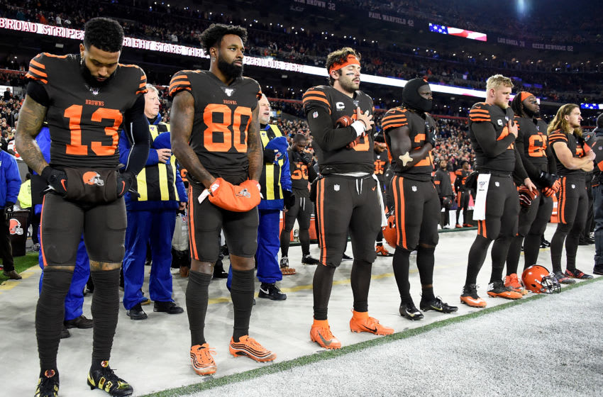 CLEVELAND, OHIO - NOVEMBER 14: Wide receiver Odell Beckham #13 of the Cleveland Browns and quarterback Baker Mayfield #6 stand during the national anthem before the game against the Pittsburgh Steelers at FirstEnergy Stadium on November 14, 2019 in Cleveland, Ohio. (Photo by Jason Miller/Getty Images)