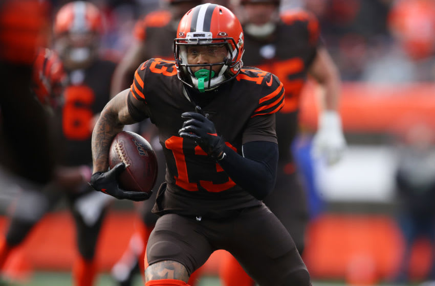 CLEVELAND, OHIO - DECEMBER 08: Odell Beckham #13 of the Cleveland Browns looks for yards after a first half catch while playing the Cincinnati Bengals at FirstEnergy Stadium on December 08, 2019 in Cleveland, Ohio. (Photo by Gregory Shamus/Getty Images)