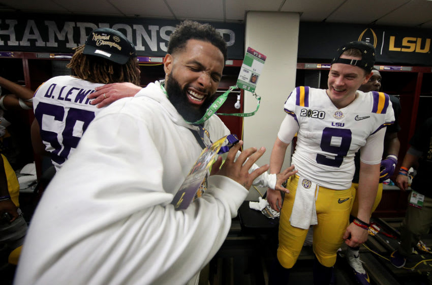 NEW ORLEANS, LOUISIANA - JANUARY 13: Odell Beckham Jr. celebrates in the locker room with Joe Burrow #9 of the LSU Tigers after their 42-25 win over Clemson Tigers in the College Football Playoff National Championship game at Mercedes Benz Superdome on January 13, 2020 in New Orleans, Louisiana. (Photo by Chris Graythen/Getty Images)