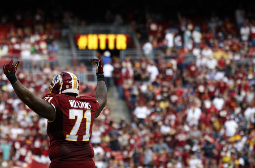 LANDOVER, MD - SEPTEMBER 20: Tackle Trent Williams #71 of the Washington Redskins signals to the crowd in the fourth quarter during a game against the St. Louis Rams at FedExField on September 20, 2015 in Landover, Maryland. (Photo by Matt Hazlett/Getty Images)
