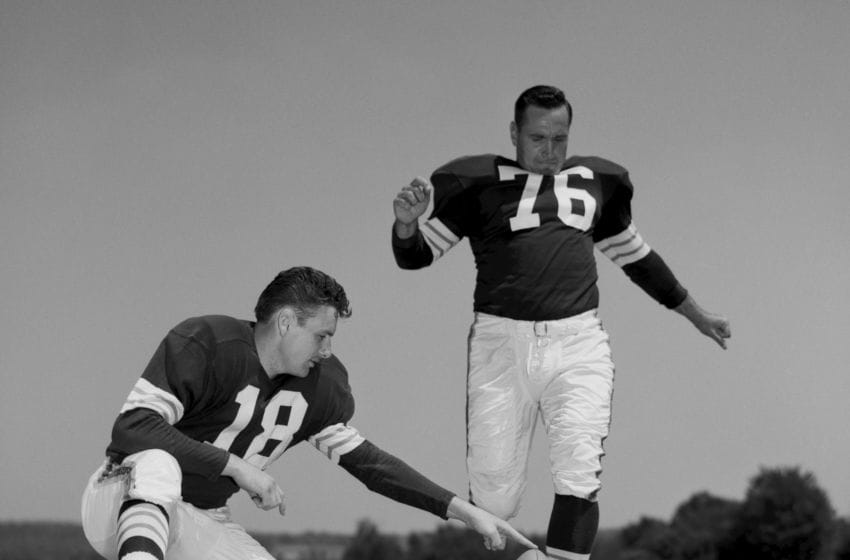 HIRAM, OH - JULY, 1960: Offensive Tackle and Placekicker Lou Groza #76, of the Cleveland Browns, poses for an action portrait during training camp in July, 1960 at Hiram College in Hiram, Ohio. Quarterback Len Dawson #18 is the holder. (Photo by: Henry Barr Collection/Diamond Images/Getty Images)