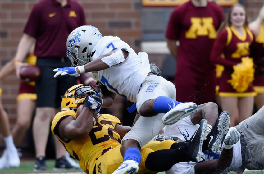 MINNEAPOLIS, MN - SEPTEMBER 16: Kobe McCrary #22 of the Minnesota Golden Gophers carries the ball for a touchdown against Jovante Moffatt #7 and Darius Harris #30 of the Middle Tennessee Raiders during the second quarter of the game on September 16, 2017 at TCF Bank Stadium in Minneapolis, Minnesota. (Photo by Hannah Foslien/Getty Images)