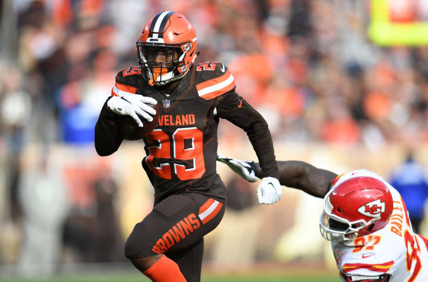 CLEVELAND, OH - NOVEMBER 04: Duke Johnson #29 of the Cleveland Browns avoids a tackle by Allen Bailey #97 of the Kansas City Chiefs during the second quarter at FirstEnergy Stadium on November 4, 2018 in Cleveland, Ohio. (Photo by Jason Miller/Getty Images)