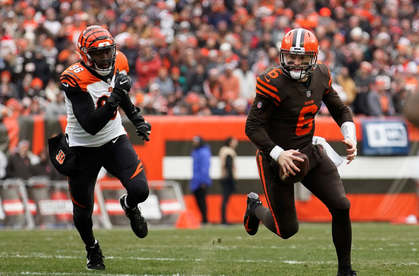 CLEVELAND, OH - DECEMBER 23: Baker Mayfield #6 of the Cleveland Browns carries the ball in front of Carlos Dunlap #96 of the Cincinnati Bengals during the second quarter at FirstEnergy Stadium on December 23, 2018 in Cleveland, Ohio. (Photo by Kirk Irwin/Getty Images)