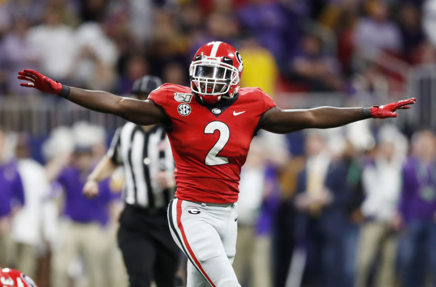 ATLANTA, GEORGIA - DECEMBER 07: Richard LeCounte #2 of the Georgia Bulldogs celebrates after a missed LSU Tigers field goal in the first half during the SEC Championship game at Mercedes-Benz Stadium on December 07, 2019 in Atlanta, Georgia. (Photo by Todd Kirkland/Getty Images)