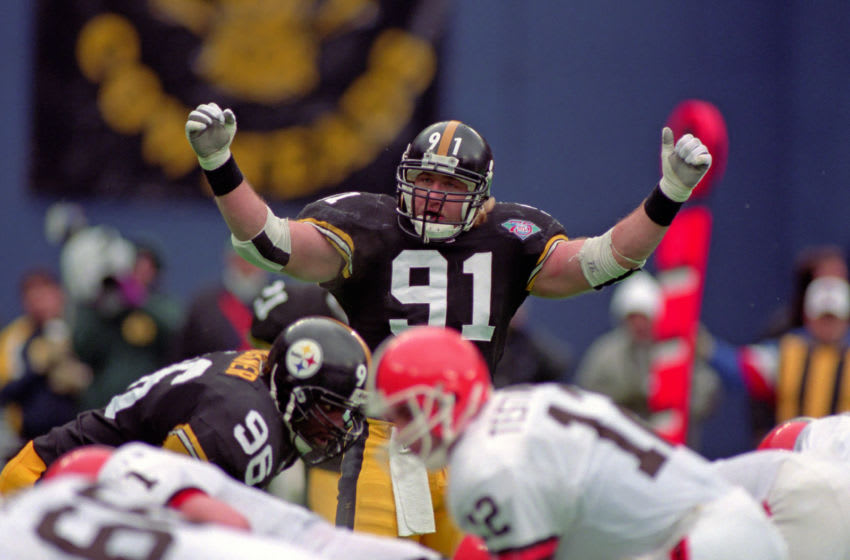 PITTSBURGH, PA - JANUARY 7: Linebacker Kevin Greene #91 of the Pittsburgh Steelers signals as defensive lineman Brentson Buckner #96 looks on from the line of scrimmage during a playoff game against the Cleveland Browns at Three Rivers Stadium on January 7, 1995 in Pittsburgh, Pennsylvania. The Steelers defeated the Browns 29-9. (Photo by George Gojkovich/Getty Images)