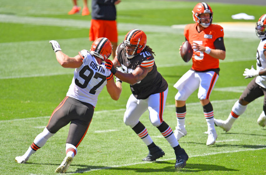 CLEVELAND, OHIO - AUGUST 30: Offensive tackle Kendall Lamm #70 blocks defensive end Porter Gustin #97 of the Cleveland Browns during training camp at FirstEnergy Stadium on August 30, 2020 in Cleveland, Ohio. (Photo by Jason Miller/Getty Images)