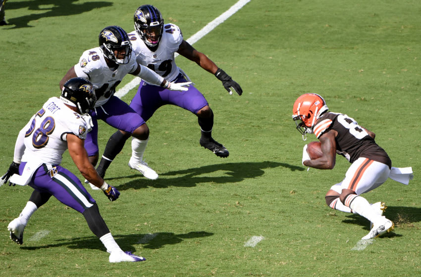 BALTIMORE, MARYLAND - SEPTEMBER 13: Jarvis Landry #80 of the Cleveland Browns is surrounded by Chris Board #49, Patrick Queen #48, and L.J. Fort #58 of the Baltimore Ravens during the game at M&T Bank Stadium on September 13, 2020 in Baltimore, Maryland. (Photo by Will Newton/Getty Images)