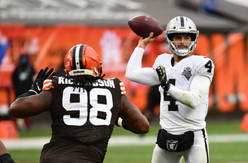 CLEVELAND, OHIO - NOVEMBER 01: Quarterback Derek Carr #4 of the Las Vegas Raiders throws a pass over defensive tackle Sheldon Richardson #98 of the Cleveland Browns during the first half of the NFL game at FirstEnergy Stadium on November 01, 2020 in Cleveland, Ohio. (Photo by Jamie Sabau/Getty Images)