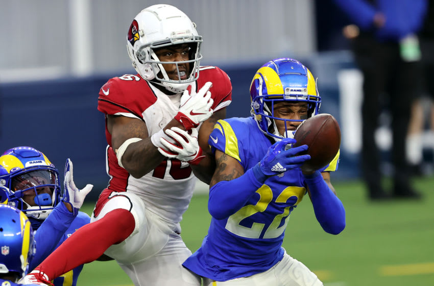 INGLEWOOD, CALIFORNIA - JANUARY 03: Troy Hill #22 of the Los Angeles Rams breaks up a pass intended for Trent Sherfield #16 of the Arizona Cardinals during the fourth quarter at SoFi Stadium on January 03, 2021 in Inglewood, California. (Photo by Sean M. Haffey/Getty Images)