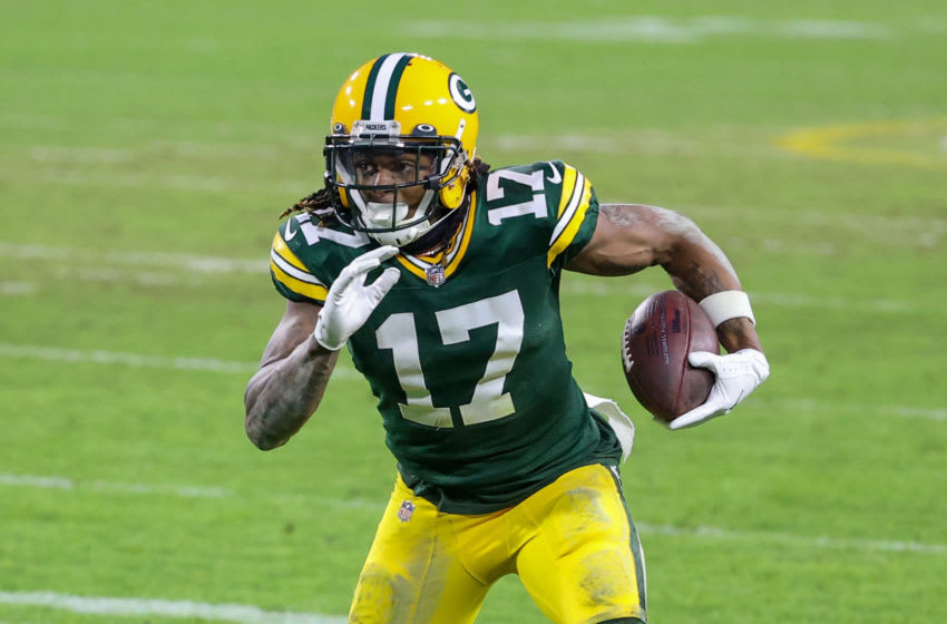 GREEN BAY, WISCONSIN - JANUARY 24: Davante Adams #17 of the Green Bay Packers runs with the ball in the fourth quarter against the Tampa Bay Buccaneers during the NFC Championship game at Lambeau Field on January 24, 2021 in Green Bay, Wisconsin. (Photo by Dylan Buell/Getty Images)