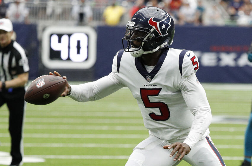 HOUSTON, TEXAS - SEPTEMBER 12: Tyrod Taylor #5 of the Houston Texans tosses the ball during the second quarter against the Jacksonville Jaguars at NRG Stadium on September 12, 2021 in Houston, Texas. (Photo by Bob Levey/Getty Images)