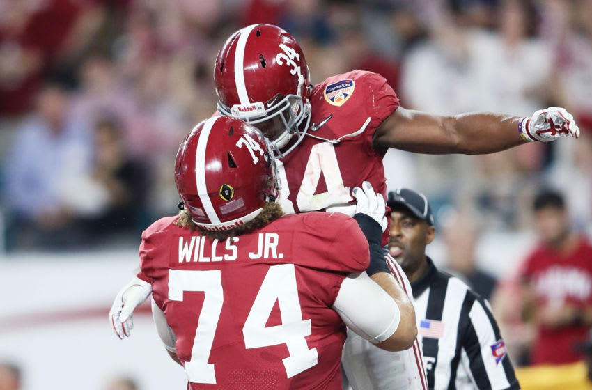 MIAMI, FL - DECEMBER 29: Damien Harris #34 of the Alabama Crimson Tide celebrates after scoring a toucdown in the first quarter during the College Football Playoff Semifinal against the Oklahoma Sooners at the Capital One Orange Bowl at Hard Rock Stadium on December 29, 2018 in Miami, Florida. (Photo by Jamie Squire/Getty Images)