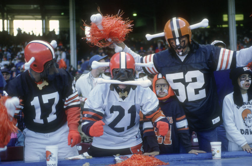 CLEVELAND, OH - CIRCA 1995: Fans of the Cleveland Browns cheer their team on from the stands during an NFL football game circa 1995 at Cleveland Municipal Stadium in Cleveland, Ohio. (Photo by Focus on Sport/Getty Images)