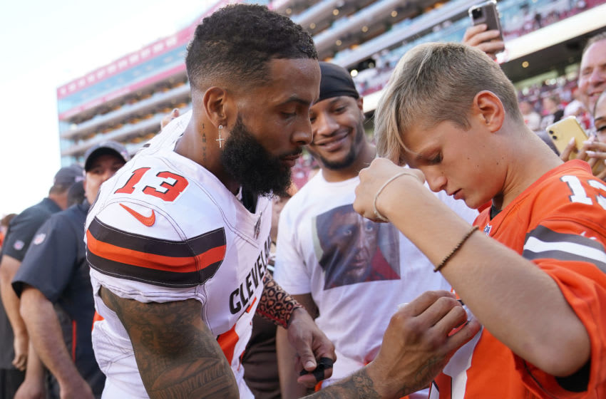 SANTA CLARA, CALIFORNIA - OCTOBER 07: Odell Beckham #13 Jr. signs an autograph for a fan prior to the start of an NFL football game against the San Francisco 49ers of the Cleveland Browns at Levi's Stadium on October 07, 2019 in Santa Clara, California. (Photo by Thearon W. Henderson/Getty Images)
