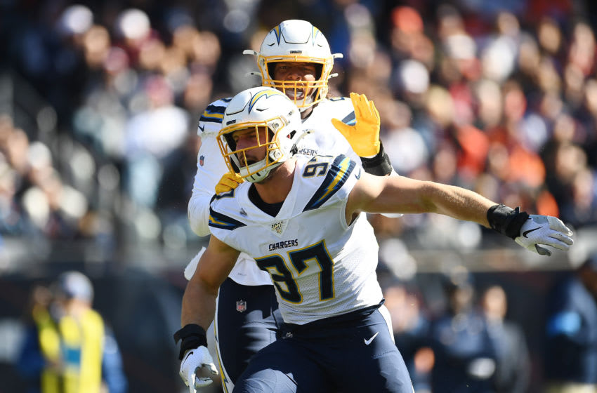 CHICAGO, ILLINOIS - OCTOBER 27: Joey Bosa #97 of the Los Angeles Chargers celebrates after sacking Mitchell Trubisky #10 of the Chicago Bears during the first quarter of a game at Soldier Field on October 27, 2019 in Chicago, Illinois. (Photo by Stacy Revere/Getty Images)