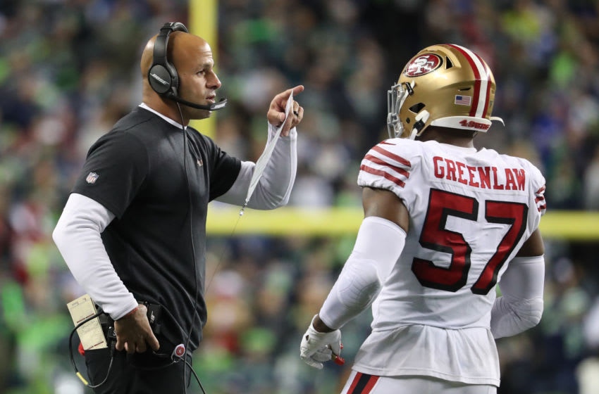 SEATTLE, WASHINGTON - DECEMBER 29: San Francisco 49ers Defensive Coordinator Robert Saleh has a conversation with Dre Greenlaw #57 of the San Francisco 49ers in the fourth quarter against the Seattle Seahawks during their game at CenturyLink Field on December 29, 2019 in Seattle, Washington. (Photo by Abbie Parr/Getty Images)